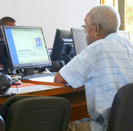 man typing on screen board